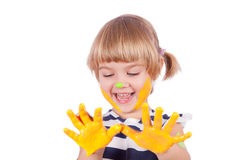 Small girl with yellow paint on her palms Royalty Free Stock Photos