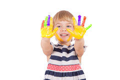 Small girl with yellow paint on her palms Stock Image