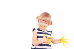 Small girl with yellow paint on her palms Stock Photos