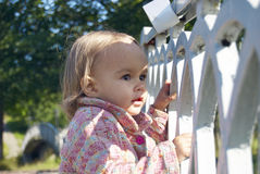 Small girls on a bridge. Small beautiful girls on the bridge in a park royalty free stock photo