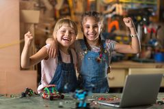 Girls cooperating while making a robot Stock Images