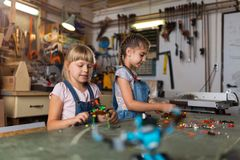 Young girls building toy construction machine Royalty Free Stock Image
