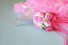 Small girls party outfit: crown and wand flowers on wooden table. bridesmaid or fairy costume. selective focus stock images