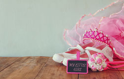 Small girls party outfit: white shoes, crown and wand flowers next to small chalkboard with phrase MY LITTLE GIRL Royalty Free Stock Photography