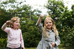 Small Girls Playing Outdoors Concept Stock Images