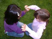 Small girls playing together. Two diverse culture girls playing together Stock Photo