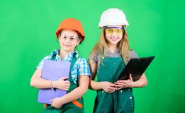 Small girls repairing together in workshop. Future profession. Builder engineer architect. Kid worker in hard hat. Child. Care development. Tools to improve royalty free stock photography
