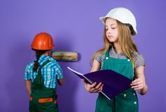 Small girls repairing together in workshop. Tools to improve yourself. Repair. Child development. Future profession. Builder engineer architect. Kid worker in stock images