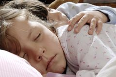 Small girls sleeping. Two small girls sleeping together, while one is embracing the other Stock Photos
