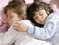 Small girls sleeping Royalty Free Stock Photos