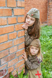 Small girls in Soviet military uniforms Royalty Free Stock Photography