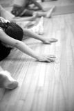 Small girls stretching on the floor Royalty Free Stock Image