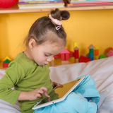 Small girls with tablet Royalty Free Stock Photography