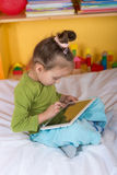 Small girls with tablet Royalty Free Stock Images
