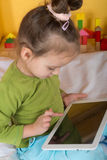 Small girls with tablet Royalty Free Stock Image