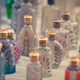 Small glass bottles for sale. Market in India royalty free stock photo