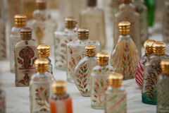Small glass bottles for sale. Market in India stock photos