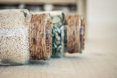 Small glass bottles with sand and rocks Stock Photos