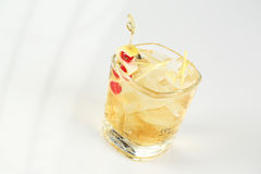 Small glass with cocktail. In studio Royalty Free Stock Photos