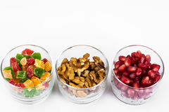Small glass with dried fruits, nuts, pomegranate Stock Photos