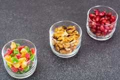Small glass with dried fruits, nuts, pomegranate Royalty Free Stock Photography
