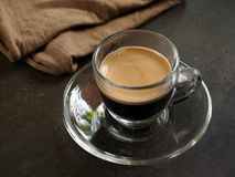 Small glass of hot espresso coffee. On table Stock Photos