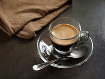 Small glass of hot espresso coffee. On table Royalty Free Stock Images
