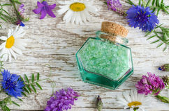 Small glass jar with aroma bath salt with flowers extract. stock photo
