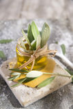Small glass jar containing olive oil Stock Photos