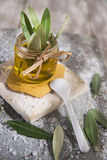 Small glass jar containing olive oil Stock Photo