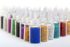 Small Glass Jars filled with Balls of Bead Stock Photos