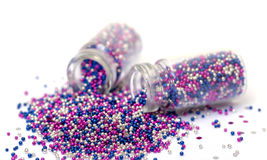 Small Glass Jars filled with Multicolored Balls of Bead Stock Images
