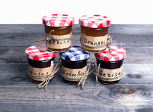 Small glass jars with lids fruit or berry jam Royalty Free Stock Photos