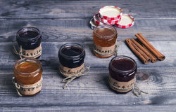 Small glass jars with lids fruit or berry jam Stock Photos