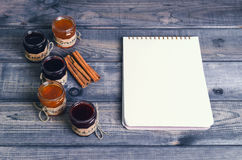 Small glass jars with lids fruit or berry jam Stock Photo