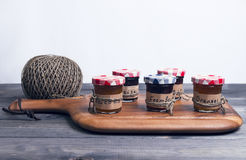 Small glass jars with lids fruit or berry jam Stock Photography