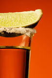 Small glass og tequila with lime Royalty Free Stock Image