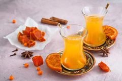 Small glasses of autumn yellow tea with swets and honey Stock Image