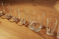 Small glasses and a big one Stock Photos