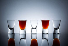 Small glasses, drink shots of alcohol with reflection Stock Images