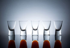 Small glasses, drink shots of alcohol with reflection Royalty Free Stock Image