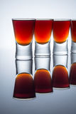 Small glasses, drink shots of alcohol with reflection Stock Image