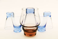 Small glasses and a large glass. Royalty Free Stock Photo