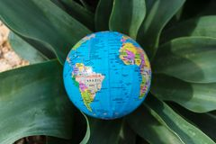 Small globe in the grass. Travel and global issues concept.  stock photo