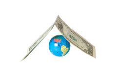 Small globe hiding under a dollar. Small globe hiding under the roof (made of a dollar bill), isolated on white Stock Photography