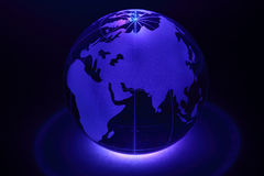Small globe is illuminated by light from below Stock Image