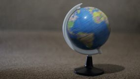 A small globe, planet rotation stock video footage