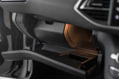 Small glovebox. Peugeot 308's small glovebox which is not very useful Royalty Free Stock Photography