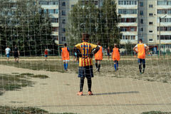 Small goalkeeper. Yoshkar-Ola, Russia. August 20, 2016: Photo football team goalkeeper back view during a soccer tournament at the festival of street sport in Royalty Free Stock Photos