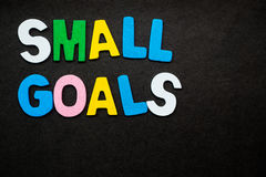 Small Goals. Colorful wooden letters forming the phrase `small goals Royalty Free Stock Photos